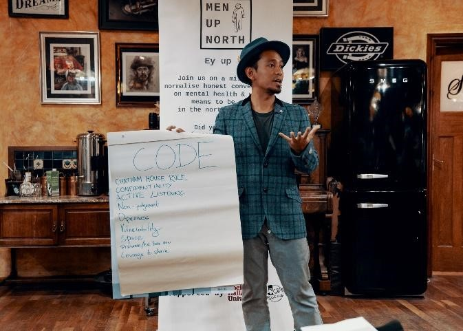 Angga discussing the code of Men Up North